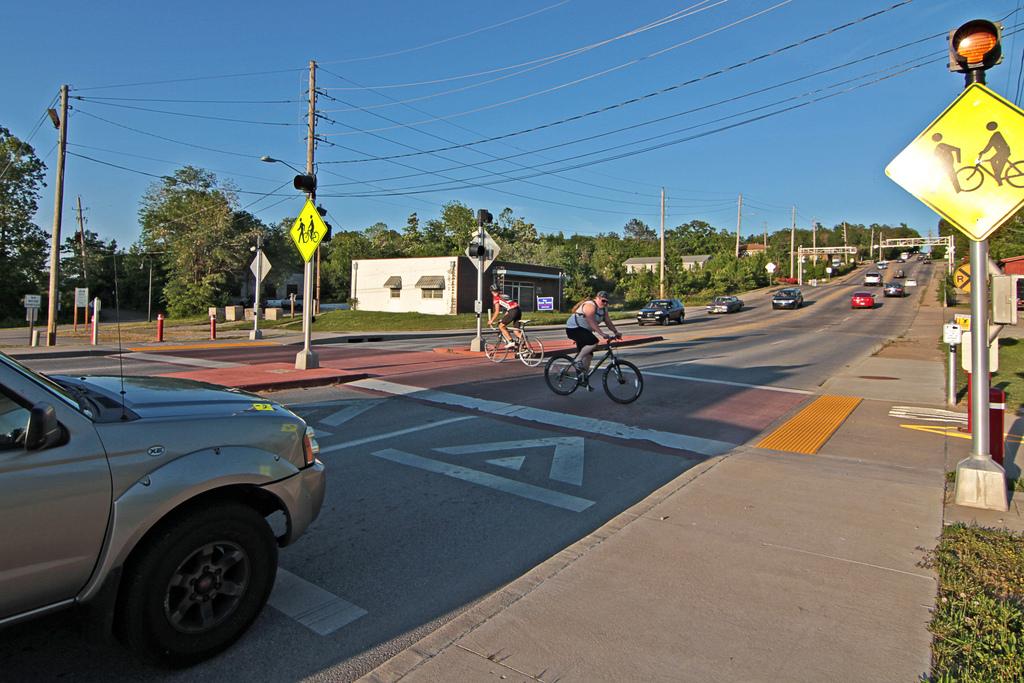 Bikers crossing road.